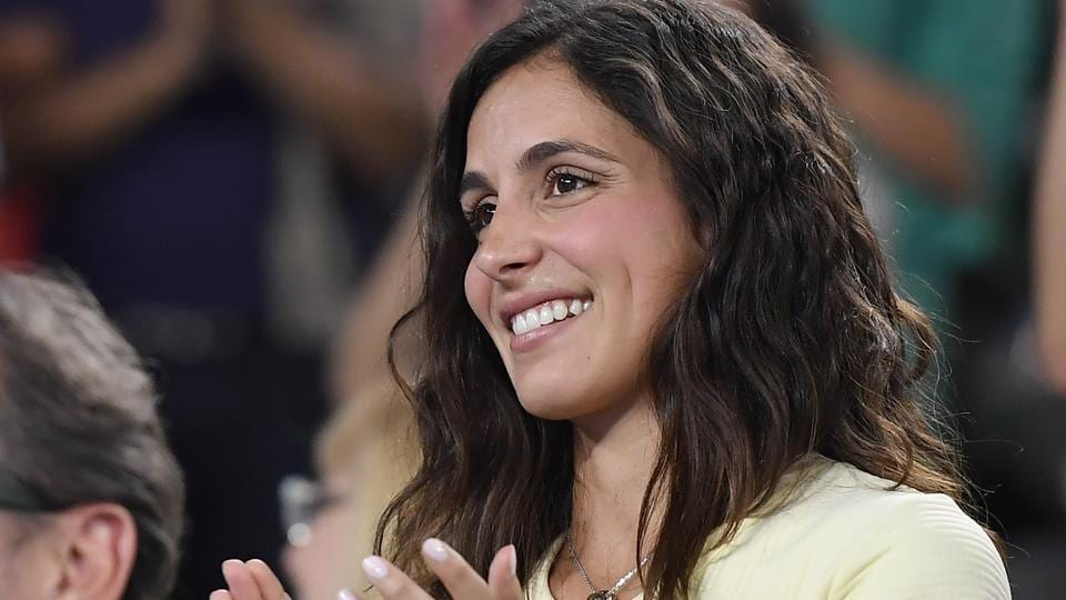 Xisca Perello, girlfriend of Spain's Rafael Nadal applauds him after his fourth round win over Gael Monfils. (AP)