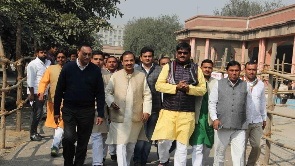 Dhirendra Singh (in yellow kurta) at the Greater Noida collectorate to file his nomination.