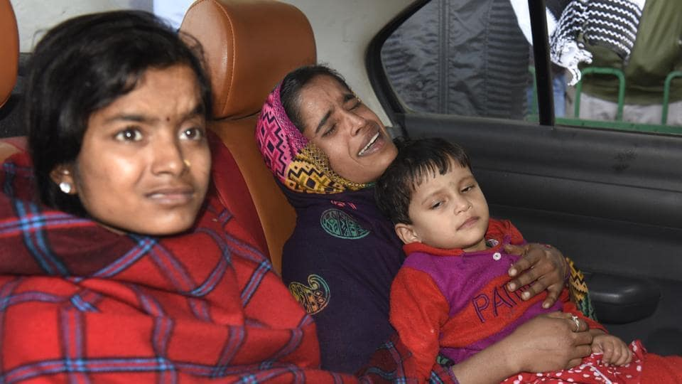 Daughter of Nazrul Islam, Lajma, in her mother's lap.