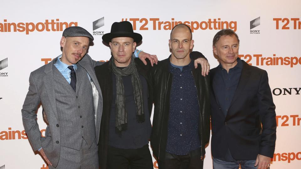 Actors, from left, Ewan Bremner, Ewan McGregor, Johnny Lee Miller and Robert Carlyle pose for photographers upon arrival at the World Premiere of the film T2 Trainspotting, in Edinburgh, Sunday.