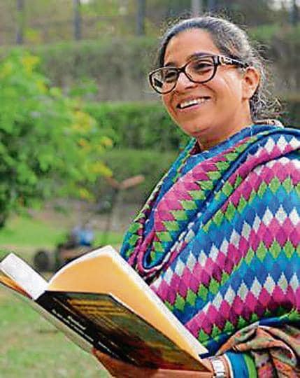 Social activist Satinder Kaur Sachdeva with her book 'Abandoned: The Dark Reality of Homeless Women'.