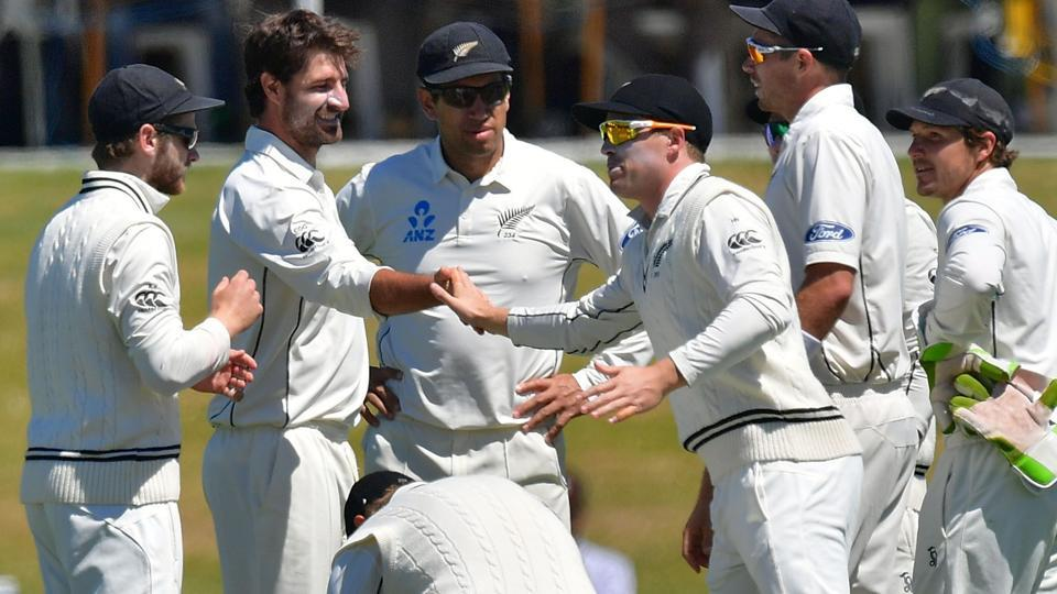 New Zealand cricket team players celebrate after getting the wicket of Bangladesh cricket team's Soumya Sarkar during the second Test at Hagley Park Oval in Christchurch on Monday