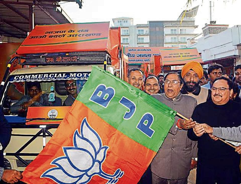 Union minister J P Nadda flags off party raths from BJP office in Dehradun on Monday.