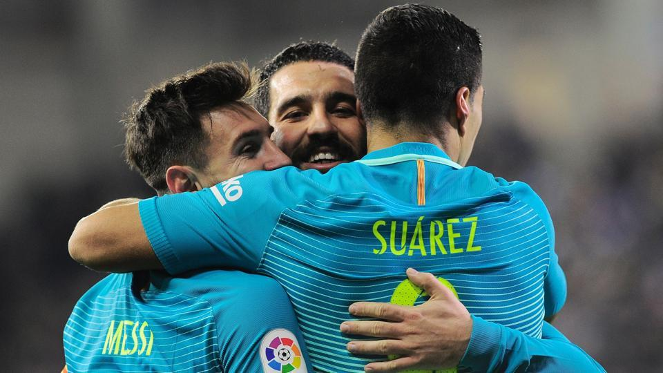 FC Barcelona's Luis Suarez (R) celebrates his goal against SD Eibar with Lionel Messi (L) and Turkish midfielder Arda Turan during their La Liga match on Sunday.