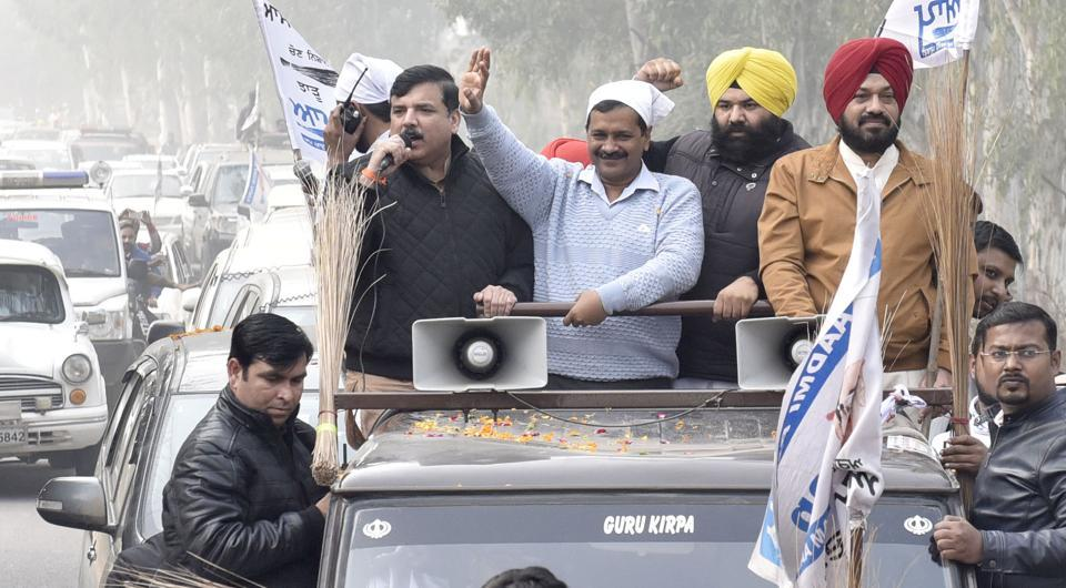AAP National Convener and Delhi chief minister Arvind Kejriwal  (centre), candidate from Majitha constituency Himmat Singh Shergill and state convener Gurpreet Ghuggi along AAP Punjab in-charge Sanjay Singh during a road show near Amritsar.