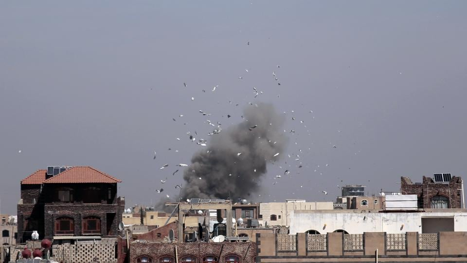 Debris and smoke rise after a Saudi-led airstrike hit an army base, in Sanaa, Yemen, Sunday, Jan. 22, 2017.