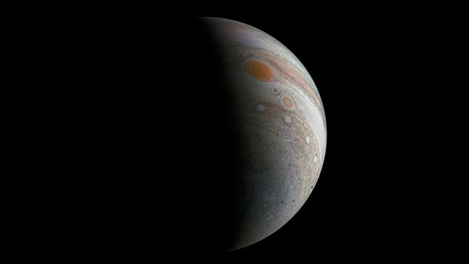 This Nasa image shows a crescent Jupiter and the Great Red Spot created by a citizen scientist (Roman Tkachenko) using data from Juno's JunoCam instrument.