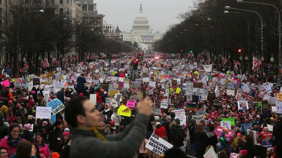 Protesters walk during the Women's March on Washington, with the U.S. Capitol in the background, in Washington, DC. Large crowds are attending the anti-Trump rally a day after U.S. President Donald Trump was sworn in as the 45th U.S. president. (Mario Tama/AFP)