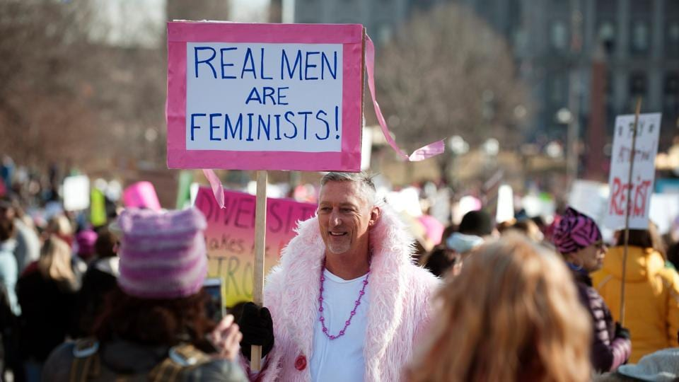 A demonstrator holds a placard in support during the Women's March at Civic Center Park in Denver, Colorado. Organizers said they drew nearly 5 million protesters in all, far surpassing crowd expectations. (Jason Connolly/AFP)