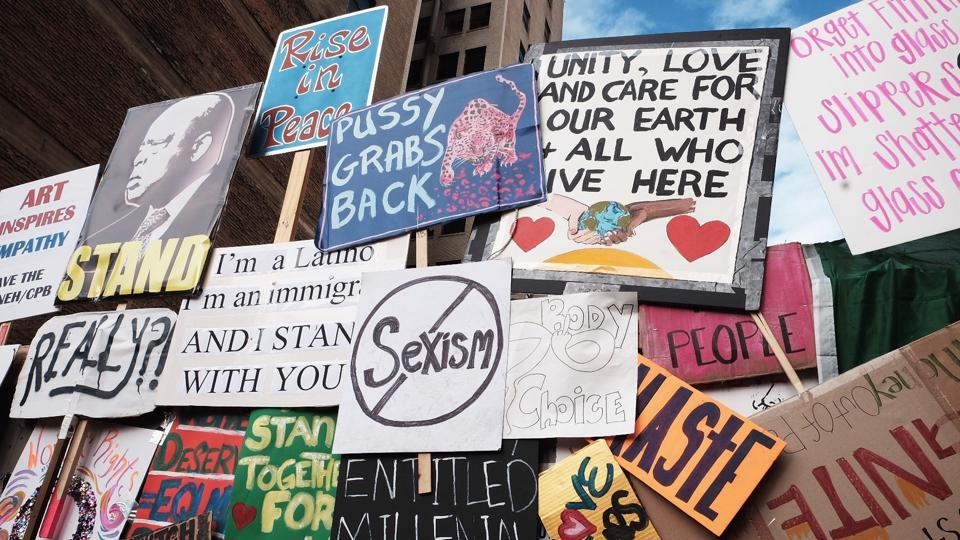 A wall featuring signs created by marchers is erected after the Women's March in Los Angeles, California.  (Sarah Morris/AFP)