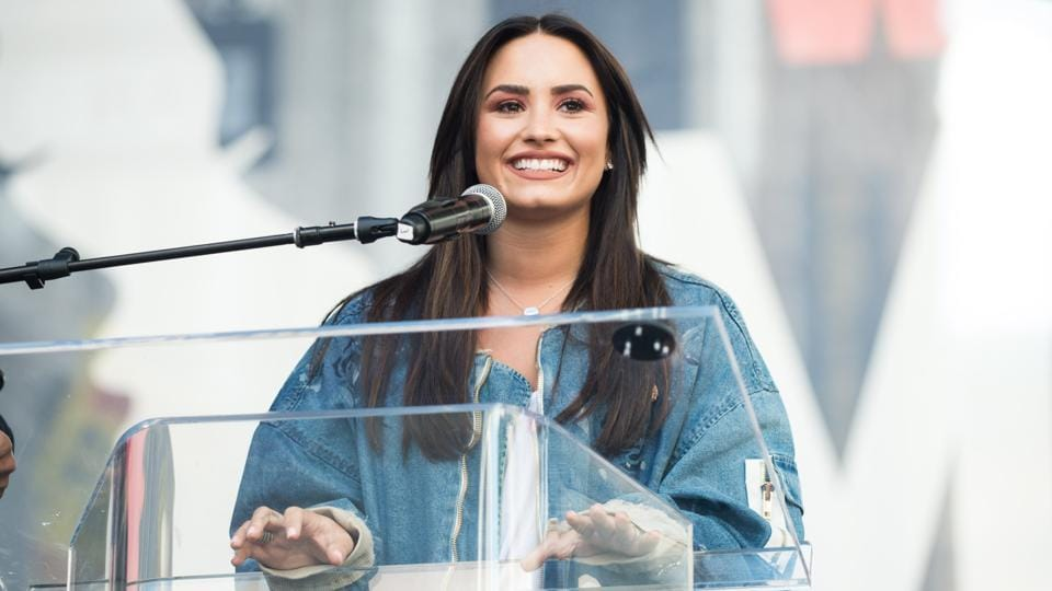 Musician Demi Lovato speaks onstage at the women's march in Los Angeles, California. (Emma McIntyre/AFP)