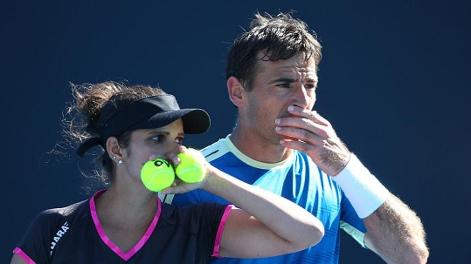 Sania Mirza of India and Ivan Dodig of Croatia during their mixed doubles Round 2 match at the Australian Open on Tuesday.
