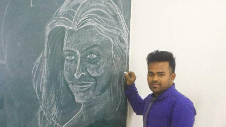 Anmoy Saha stands next to a sketch of Bollywood actor Aishwarya Rai Bachchan.