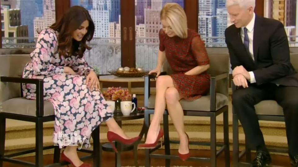 Priyanka Chopra and hosts Kelly Ripa and Anderson Cooper talked about her recent win at the People's Choice Awards, how she was recently hurt at the sets of her show and suffered a concussion and how she and Kelly were wearing the same shoes.