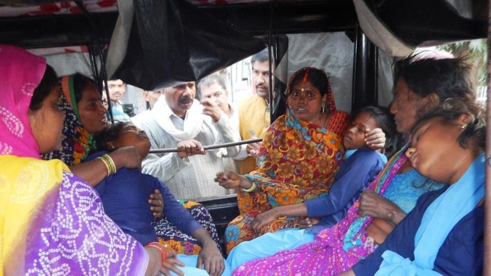 Family members taking injured girls to hospital.