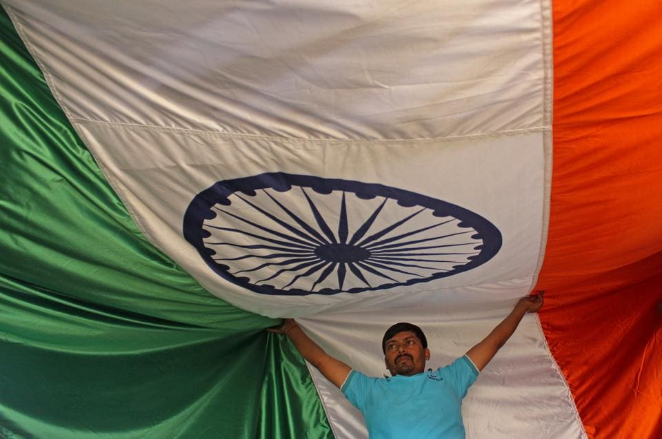 Workers inspect the Tricolour at a workshop ahead of Republic Day at Vasai in Mumbai. (Satyabrata Tripathy/HT photo)