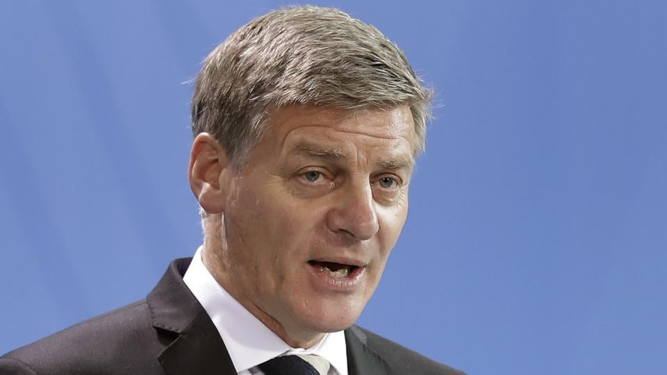 New Zealand's Prime Minister Bill English addresses the media during a joint news conference with German Chancellor Angela Merkel following US President Donald Trump's decision to pull out of the Trans-Pacific Partnership.