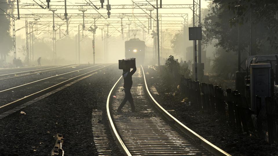 Trains were delayed due to fog at Tilak Bridge railway station in New Delhi.