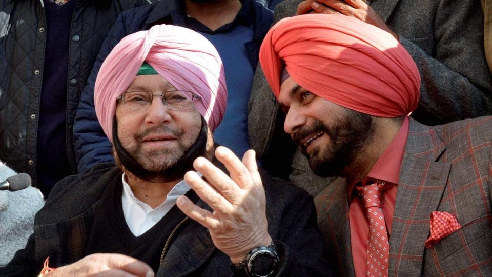 Punjab Pradesh Congress Committee president Amarinder Singh with former cricketer Navjot Singh Sidhu during a joint press conference in Amritsar recently.