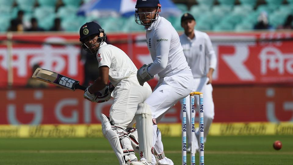 England's wicket keeper Jonny Bairstow  watches as India's Wriddhiman Saha plays a shot during the second day of the second Test cricket match between India and England at the Dr. Y.S. Rajasekhara Reddy ACA-VDCA Cricket Stadium in Vishakhapatnam on November 18, 2016.