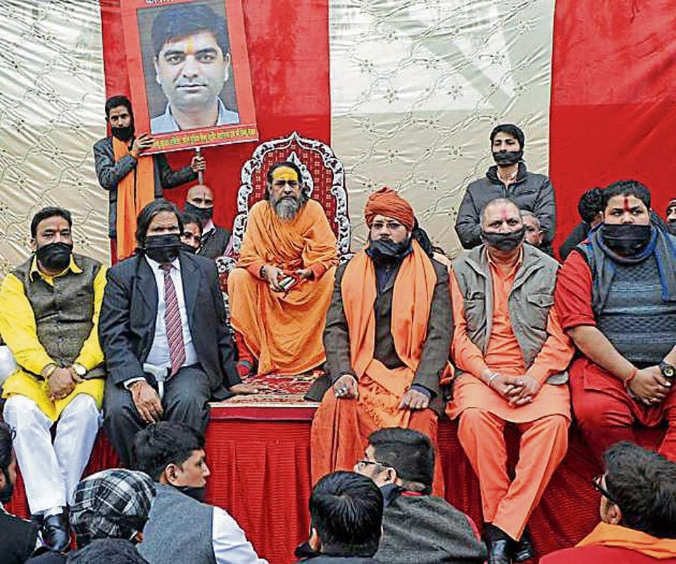 Members of Shri Hindu Takht holding a silent protest with black cloth tied around their mouths in front of Shri Durga Mata Mandir in Ludhiana on Tuesday.