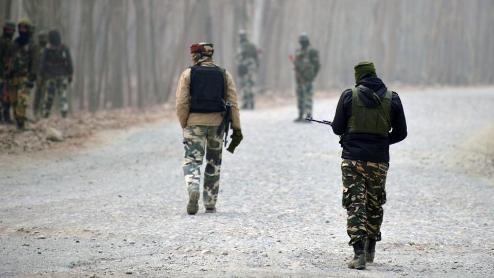 Indian paramilitary troopers stand guard near the site of a gunbattle between suspected militants and Indian security personnel at Arwani Bijbehara, south of Srinagar, in this file photo from December 8, 2016.