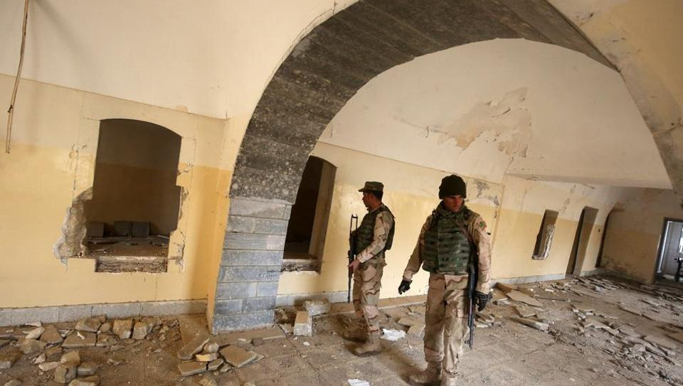 Iraqi soldiers inspect the debris on January 22, 2017 at St. George's Monastery (Mar Gurguis), a historical Chaldean Catholic church on the northern outskirt of Mosul, which was destroyed by Islamic State (IS) group in 2015.