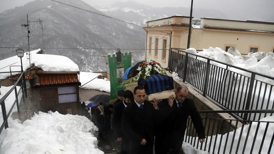 The coffin of Alessandro Giancaterino, one of the victims of the avalanche which buried the Hotel Rigopiano, is shoulder carried prior to the start of the funeral service in Farindola, central Italy,on Tuesday.