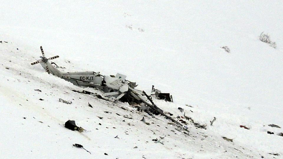 The wreckage of an helicopter lies in the snow after crashing in the Campo Felice ski area, central Italy.