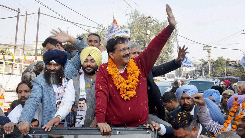 AAP convener and Delhi chief minister Arvind Kejriwal waves to supporters during a road show in Jalandhar for the upcoming Punjab assembly elections.