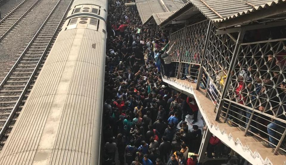 Shah Rukh Khan fans wait for his arrival at the Nizamuddin railway station.  One fan was killed in a stampede at the Vadodara railway platform during the promotion of his film  Raees.