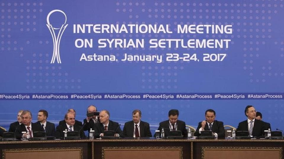 Participants of Syria peace talks attend a meeting in Astana, Kazakhstan.