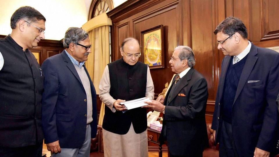 Former revenue secretary, NK Singh presenting the Report on Fiscal Responsibility and Budget Management (Representation of Report) to finance minister Arun Jaitley in New Delhi on Monday.