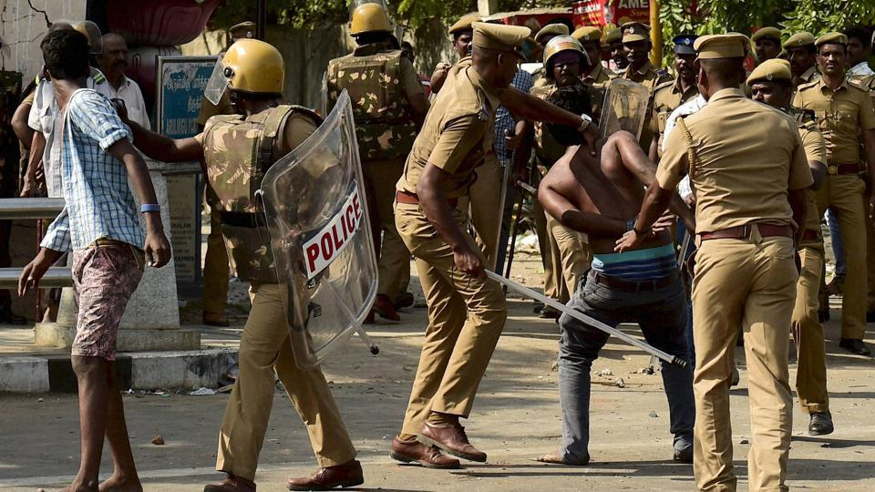 Police resort to lathicharge to disperse Jallikattu protesters near Marina Beach in Chennai on Monday.
