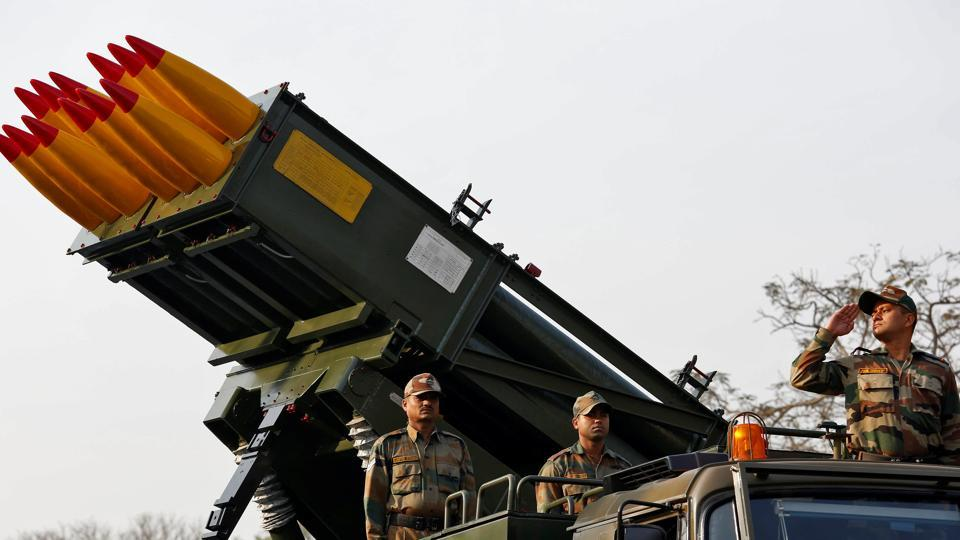 Army officers stand on Indian Army's Pinaka multi-barrel rocket launcher system during a rehearsal for Republic Day parade in Kolkata.