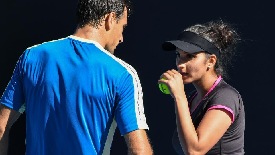 Sania Mirza (R) speaks with Croatia's Ivan Dodig during their mixed doubles match at the Australian Open. (AFP)