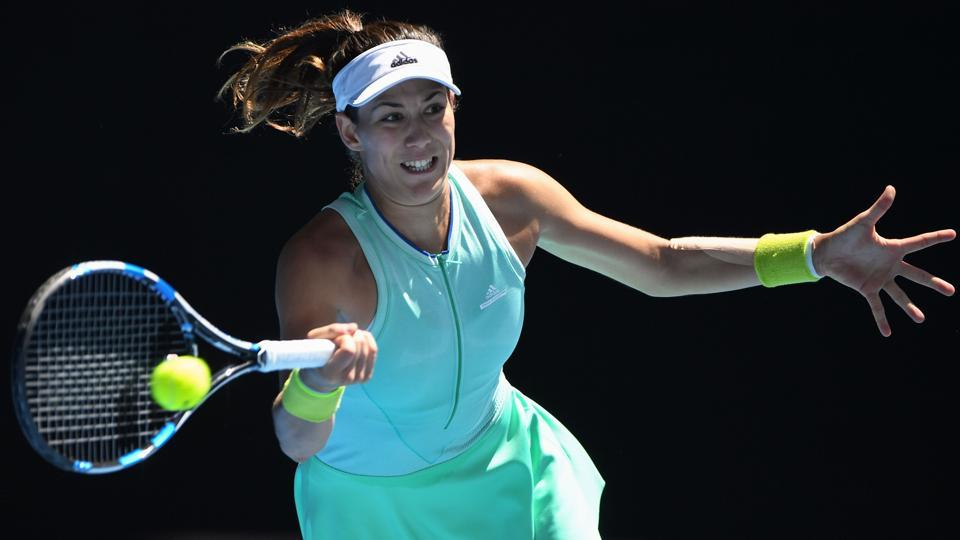 Spain's Garbine Muguruza hits a return against Coco Vandeweghe of the US during their women's singles quarter-final match on day nine of the Australian Open. (AFP)