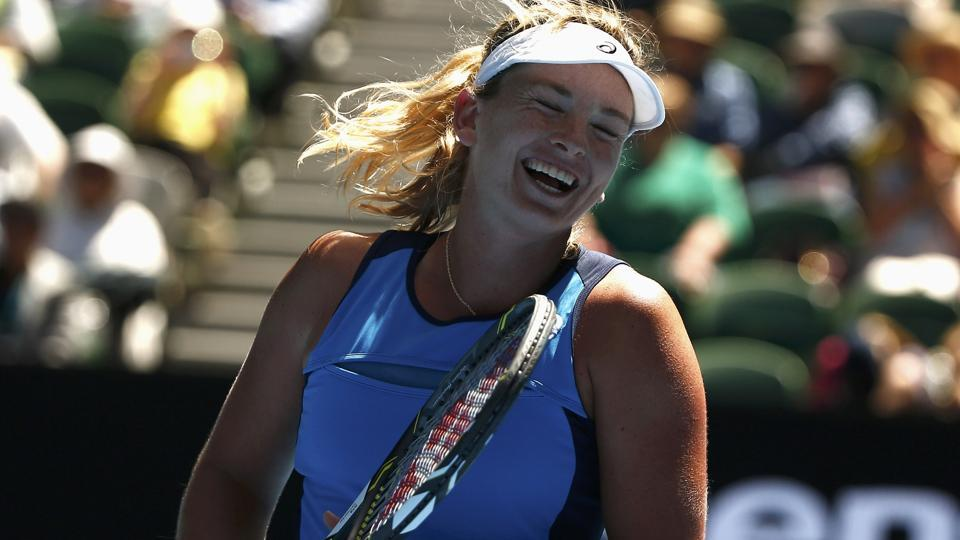 Coco Vandeweghe celebrates after beating Spain's Garbine Muguruza at the Australian Open on Tuesday.