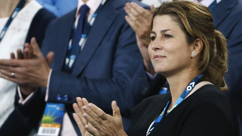 Mirka Federer, wife of Switzerland's Roger Federer, celebrates after he won his Men's singles quarter-final match. (REUTERS)