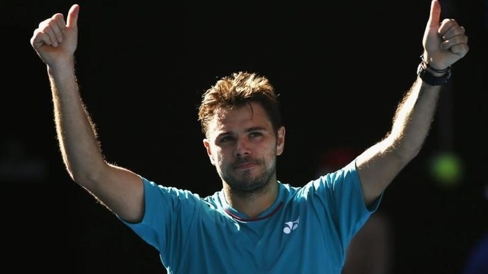 Switzerland's Stan Wawrinka celebrates winning his Men's singles quarter-final match against France's Jo-Wilfried Tsonga.  (REUTERS)