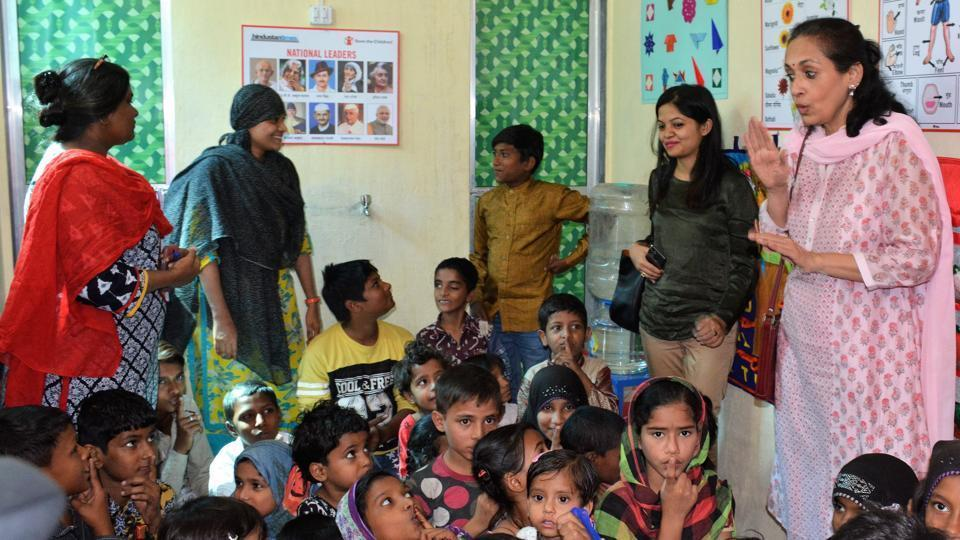 Actor and governing board member of Save the Children Swaroop Rawal interacts with kids at a community centre.