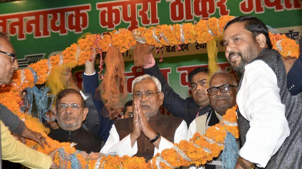 Former JD(U) national president Sharad Yadav with Bihar chief minister Nitish Kumar garlanded by party workers during the 93rd birth anniversary celebrations of Karpoori Thakur at S K M hall in Patna on Tuesday.