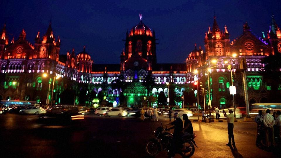 Chatrapati Shivaji Terminus lit up in tri-colour on the eve of Republic Day in Mumbai on Wednesday. (PTI)