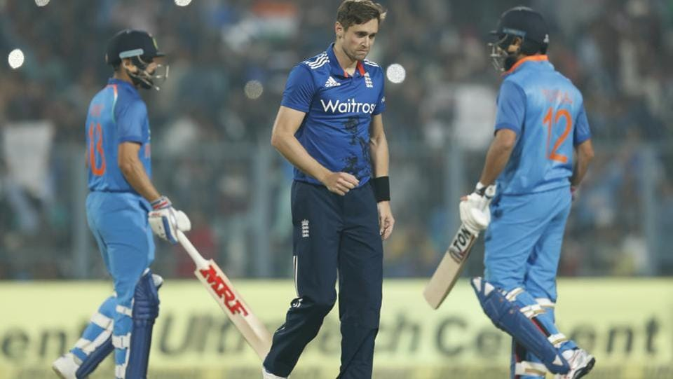 England's Chris Woakes gestures after India's captain Virat Kohli hits a four during their third one day international cricket match at Eden Gardens in Kolkata, India, Sunday, Jan. 22, 2017. Live streaming of the 1st T20 between India vs England in Kanpur is available.