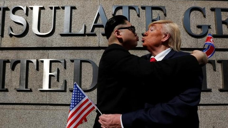 Dennis Alan of Chicago, 66, who is impersonating US President Donald Trump, and Howard, 37, an Australian-Chinese who is impersonating North Korean leader Kim Jong-un, pose outside US Consulate in Hong Kong, China, on Wednesday.