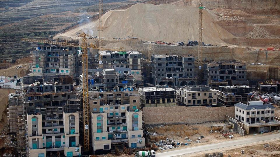This file photo taken on December 28, 2016 shows a partial view of the Israeli settlement of Givat Zeev near the West Bank city of Ramallah.