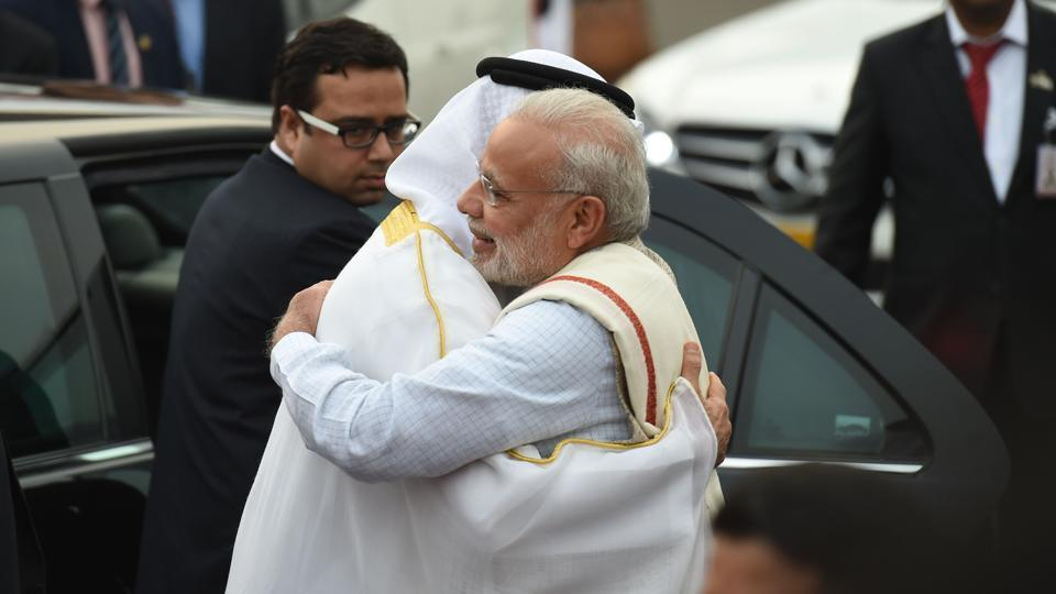 The Crown Prince of Abu Dhabi, Sheikh Mohammed Bin Zayed Al Nahyan, is greeted by Prime Minister Narendra Modi as he arrives at the air force station in New Delhi.