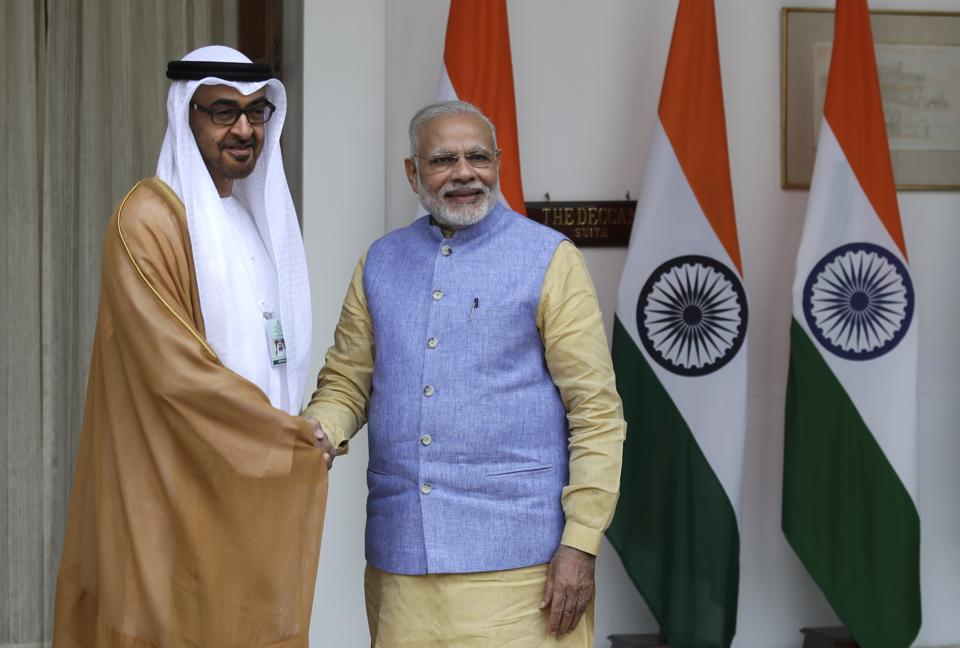 Prime Minister Narendra Modi shakes hand with Abu Dhabi's Crown Prince Sheikh Mohammed bin Zayed Al Nahyan before their meeting in New Delhi on Wednesday.
