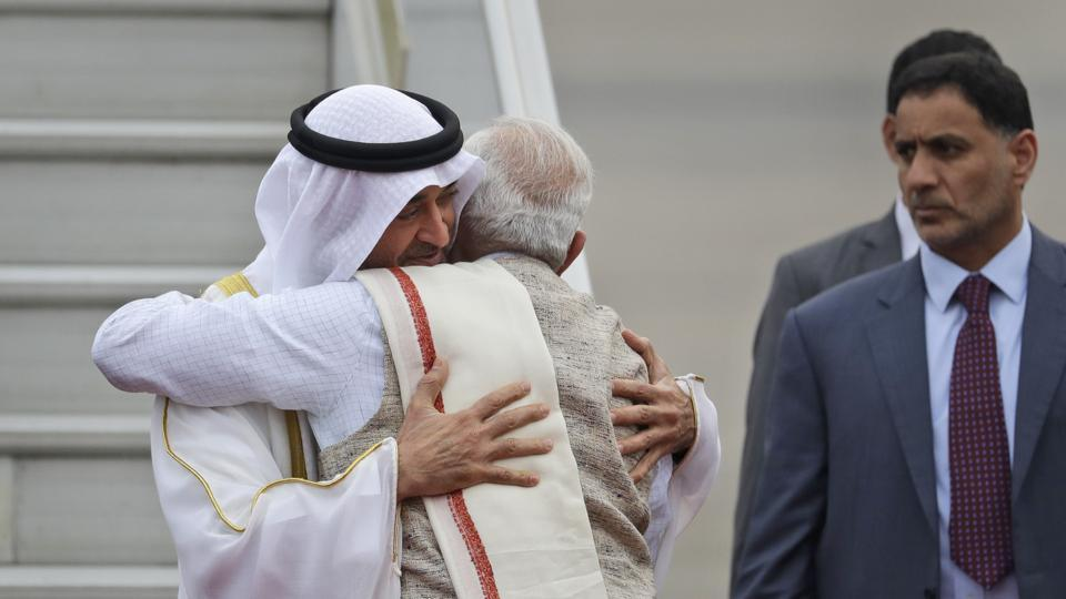 Prime Minister Narendra Modi hugs Abu Dhabi's crown prince Sheikh Mohammed bin Zayed Al Nahyan as he receives him at the airport in New Delhi, January 24.