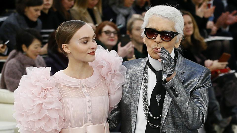 Lily-Rose Depp models with German fashion designer Karl Lagerfeld during Chanel's Haute Couture Spring-Summer 2017 fashion collection prsented in Paris on Tuesday. (AP)